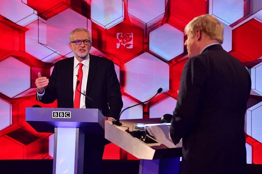 British PM Boris Johnson (right) and main opposition leader Jeremy Corbyn participate in the BBC Prime Ministerial leaders debate.