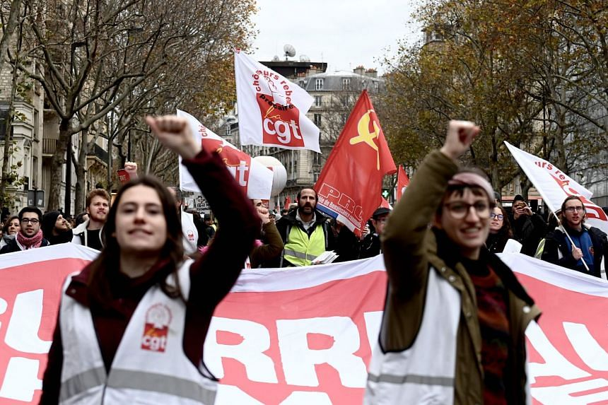 French unionists demonstrate in Paris on Dec 7, 2019.