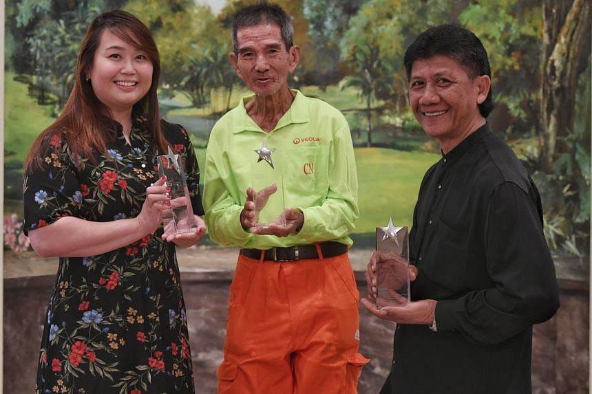 (From left) Ms Regina Cheah, Mr Low Kum Chuen and Mr Raship Othman, winners of the inaugural Environmental Services Star Awards.