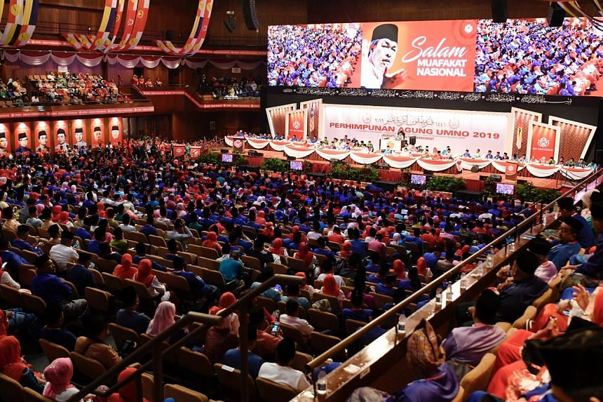 Umno delegates singing the party anthem at the Umno General Assembly on Dec 7, 2019.