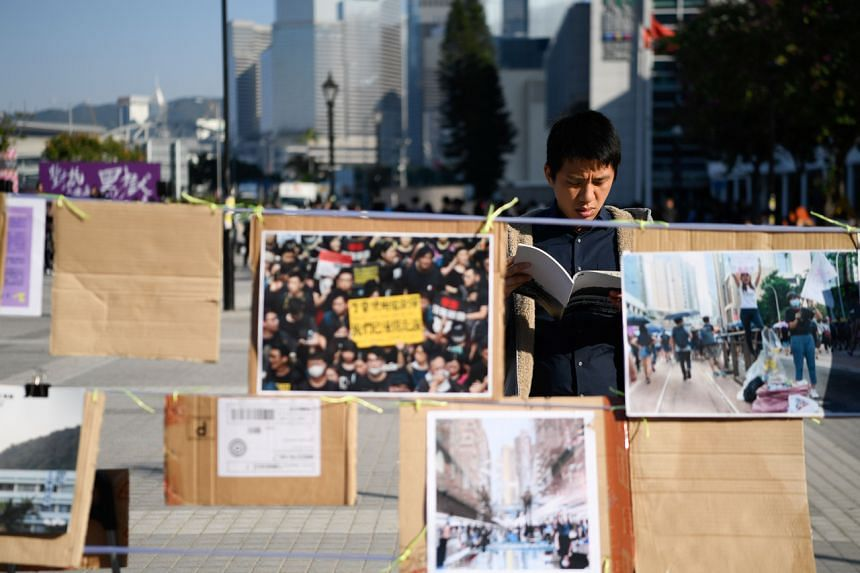 An exhibit of Indonesian domestic worker and journalist Yuli Riswati's work at a rally to support her after she was deported, in Hong Kong's Central district on Dec 7, 2019.