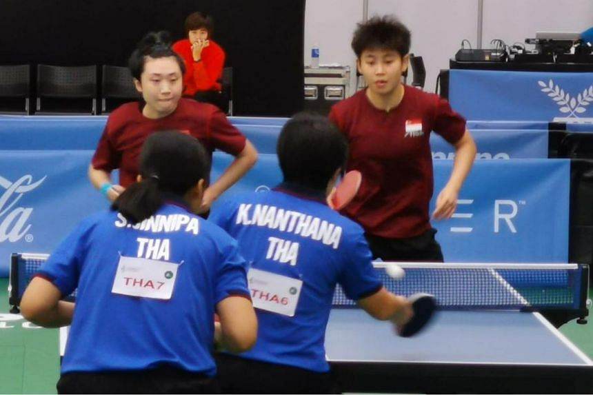 Singapore's Feng Tianwei (left) and Lin Ye in action against Thailand's Nanthana Komwong and Jinnipa Sawaettabut.