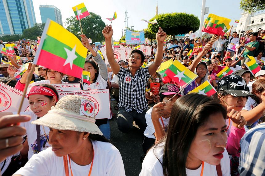 A photo taken in Yangon on Dec 1, 2019, shows a rally in support of Myanmar State Counsellor Aung San Suu Kyi, before she heads off to the International Court of Justice.