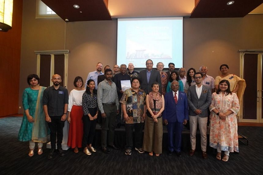 "Minister for Communications and Information S Iswaran (centre) with editors and contributors of ""From Sojourners to Settlers - Tamils in Southeast Asia and Singapore"" and staff from The Indian Heritage Centre."