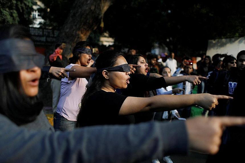 People wearing blindfolds taking part in a protest yesterday to show their solidarity with rape victims and oppose violence against women in India. PHOTO: REUTERS