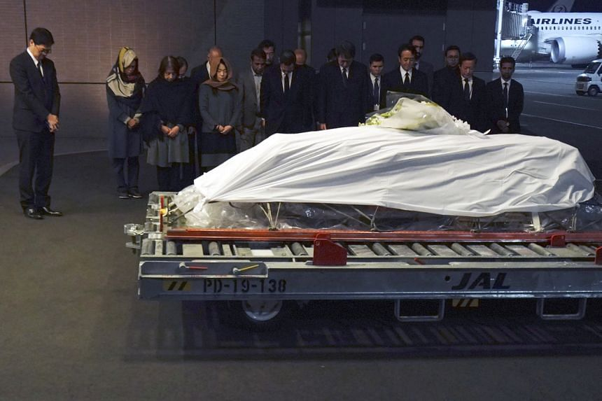 The body of Japanese doctor Tetsu Nakamura arrives at Tokyo's Narita International Airport on Dec 8, 2019.