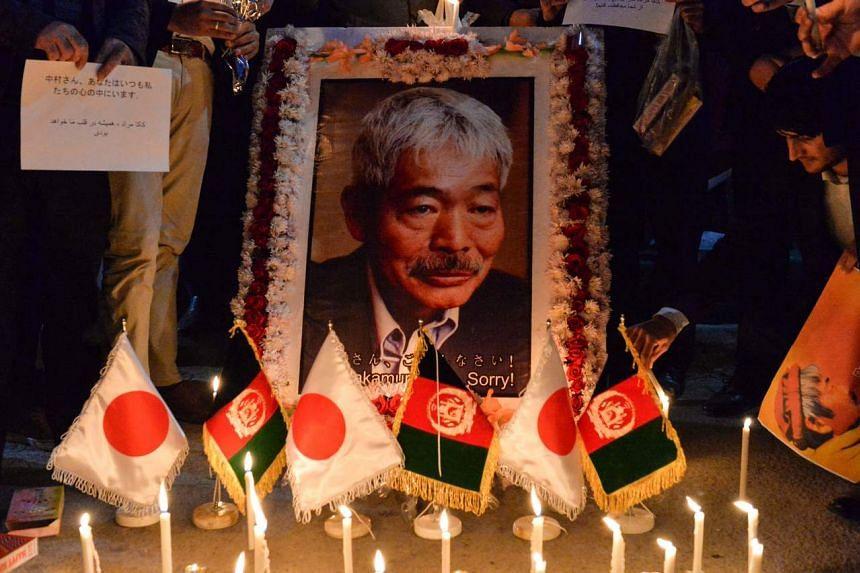 A candlelight vigil for slain Japanese doctor Tetsu Nakamura in Kabul on Dec 5, 2019.