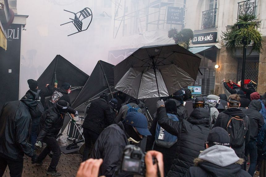 Anti-riot police officers and protesters clash in Nantes, France, on Dec 7, 2019.