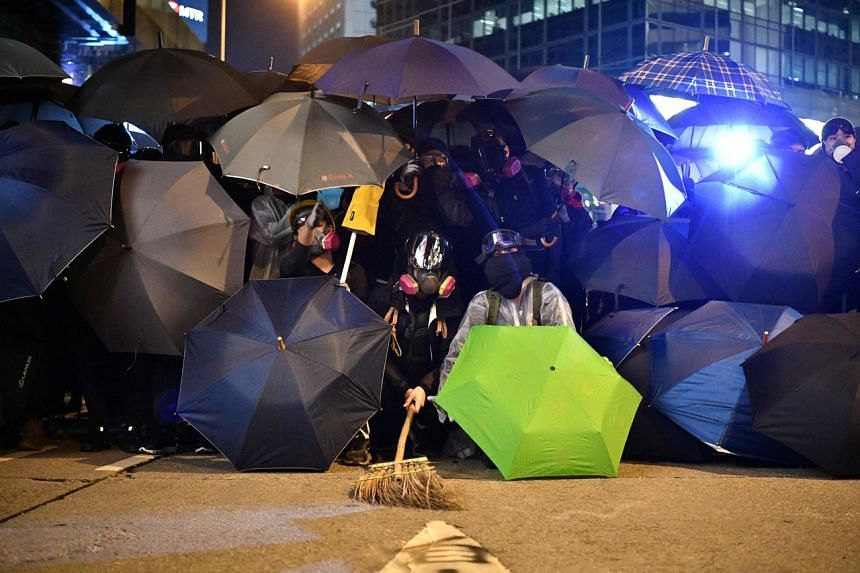 Protesters form a frontline against police in Hong Kong's Central district on Dec 8, 2019.