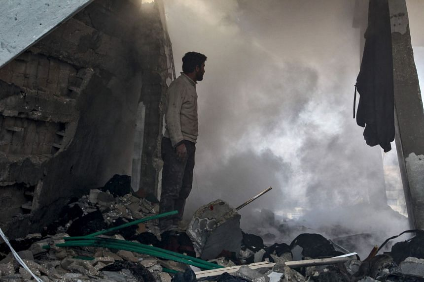 A man stands amid rubble following a reported air strike in the village of Balyun in Syria's northwestern Idlib province on Dec 7, 2019.