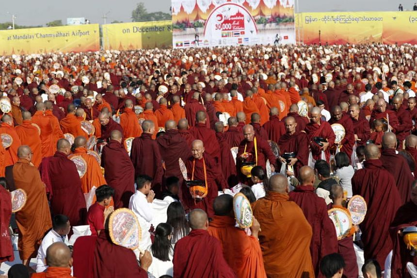 Buddhist monks from Myanmar and Thailand and senior religious officials from a dozen countries collecting alms during the event in Mandalay on Dec 8, 2019.