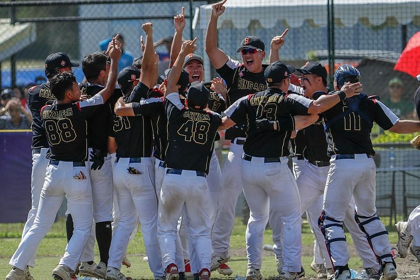 """Singapore's softball men celebrating a historic first gold, with teen pitcher """"Big Al"""" shining in the 6-1 grand final win over the Philippines, who had won eight of the previous nine editions the sport has featured."""