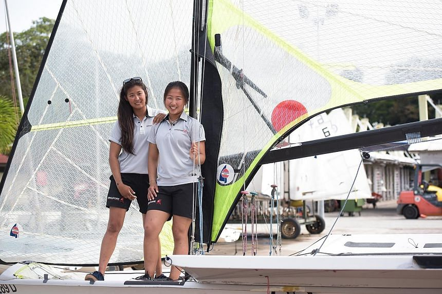 """Asian Games 49erFX champions Cecilia Low (left) and Kimberly Lim endured """"messy and unpredictable"""" weather to finish 15th in the 49er, 49erFX and Nacra 17 World Championships in Auckland, New Zealand."""
