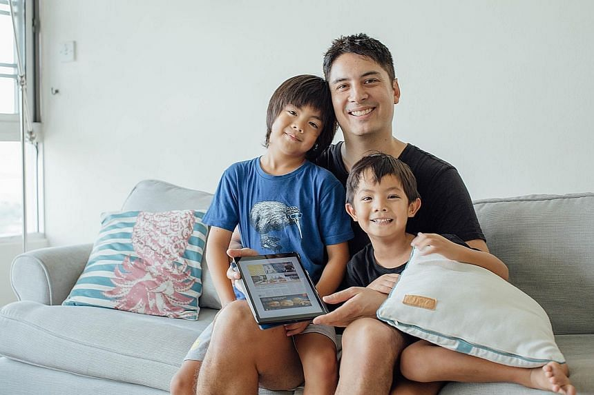 For Kiss92 FM deejay Shan Wee, the tablet is a great way for his children - Ciaran, seven, and Ruan, five - to learn English as technology takes an ever-increasing role in their lives. ST PHOTO: SAMUEL RUBY