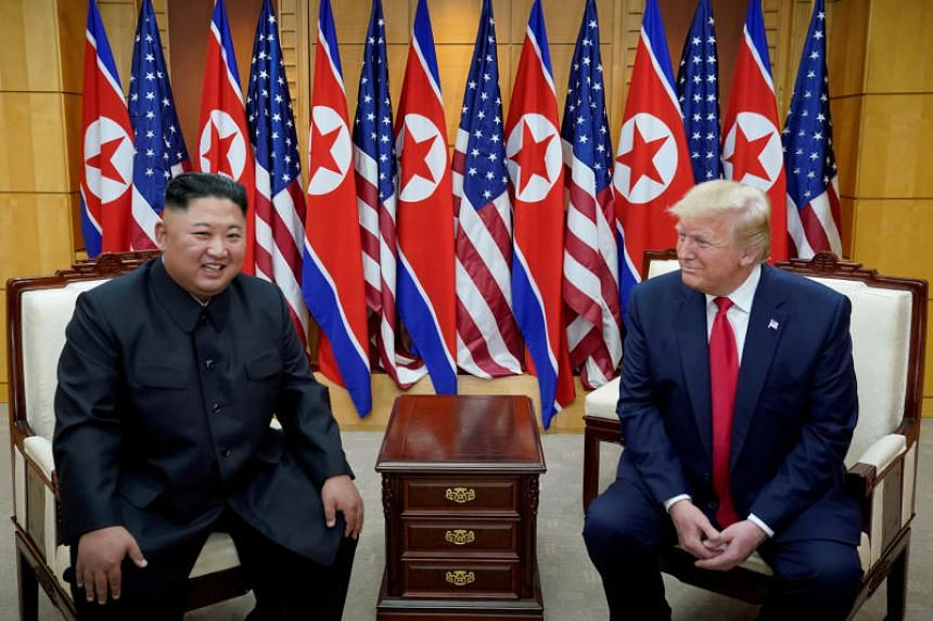 In a photo taken on June 30, 2019, US President Donald Trump (right) meets with North Korean leader Kim Jong Un at the demilitarised zone separating the two Koreas, in Panmunjom, South Korea.