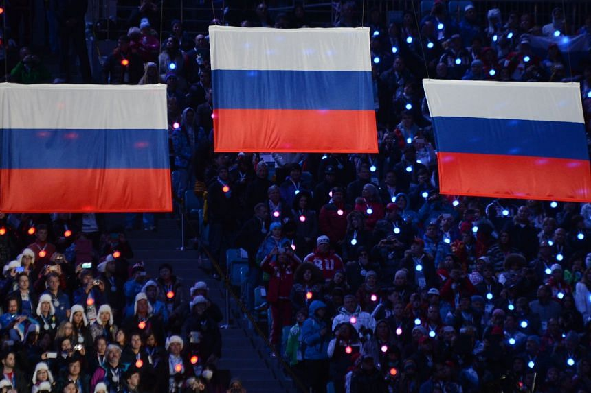 In a photo taken on Feb 23, 2014, Russia's flags are raised during the closing ceremony of the 2014 Sochi Winter Olympics.