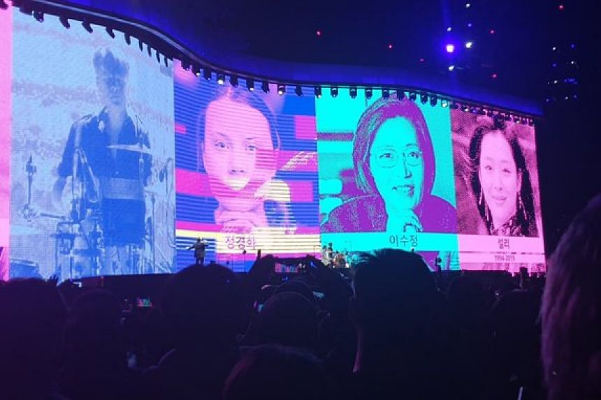 Photos of women who had made headlines in South Korea were shown on screens during U2's performance of Ultraviolet (Light My Way).
