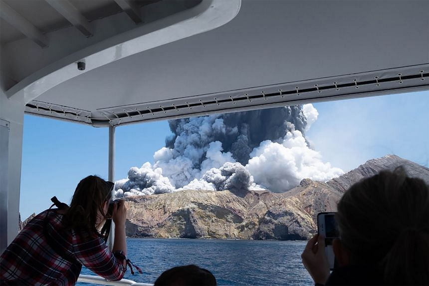 Smoke billows from the White Island volcano as it erupts, north-east of the North Island town of Tauranga, New Zealand, on Dec 9, 2019.