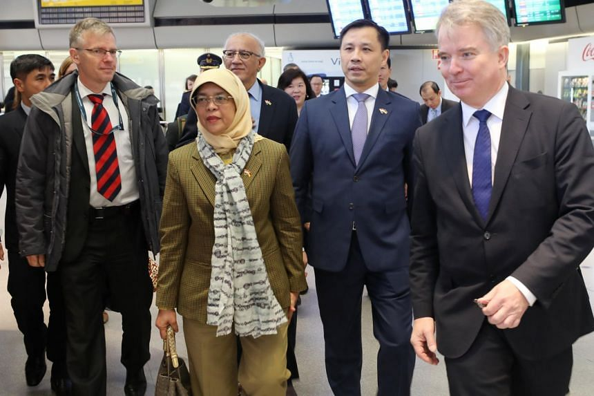 (From right) German Chief of Protocol Konrad Arz von Straussenburg, Singapore's ambassador to Germany Laurence Bay and President Halimah, with her husband Mr Mohamed Abdullah Alhabshee, in Berlin on Dec 9 for her five-day state visit to Germany.