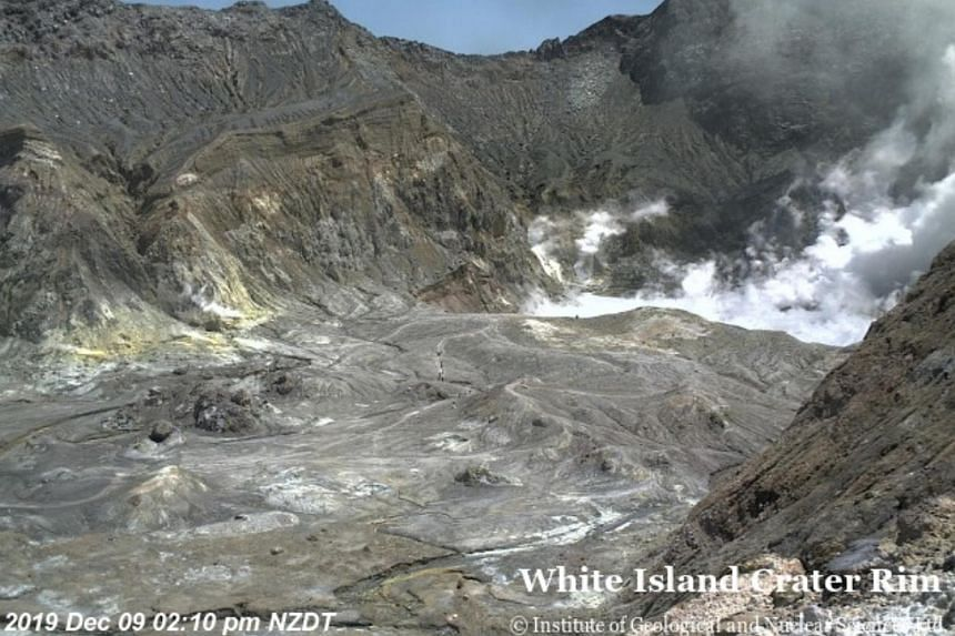 A live feed from the volcano showed more than half a dozen people walking inside the rim at 2.10pm local time.