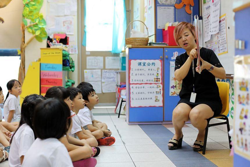 Children having a lesson with Chinese teacher Lu Bin (left) at Zion Kindergarten.