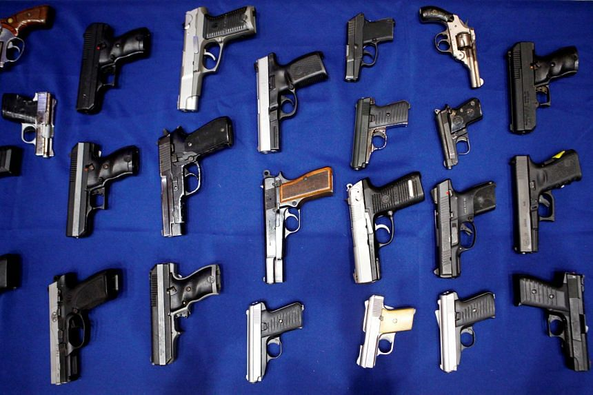 Seized handguns are pictured at the police headquarters in New York.