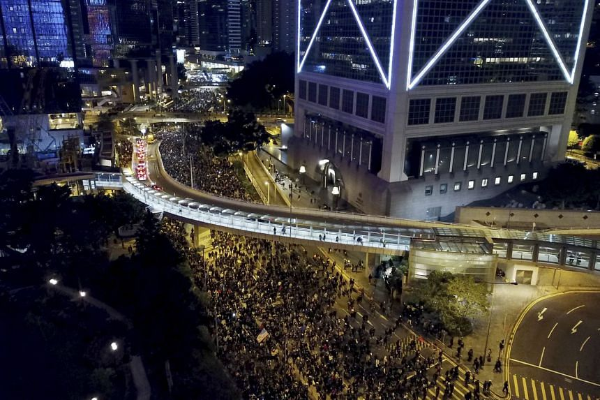 Pro-democracy protesters march into the night in Hong Kong, on Dec 8, 2019.