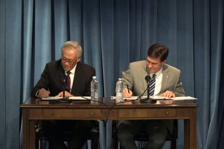 Minister for Defence Dr Ng Eng Hen (left) and US Secretary of Defence Mark Esper sign the Memorandum of Understanding concerning the establishment of a Republic of Singapore Air Force Fighter Training Detachment at Andersen Air Force Base, Guam, on t