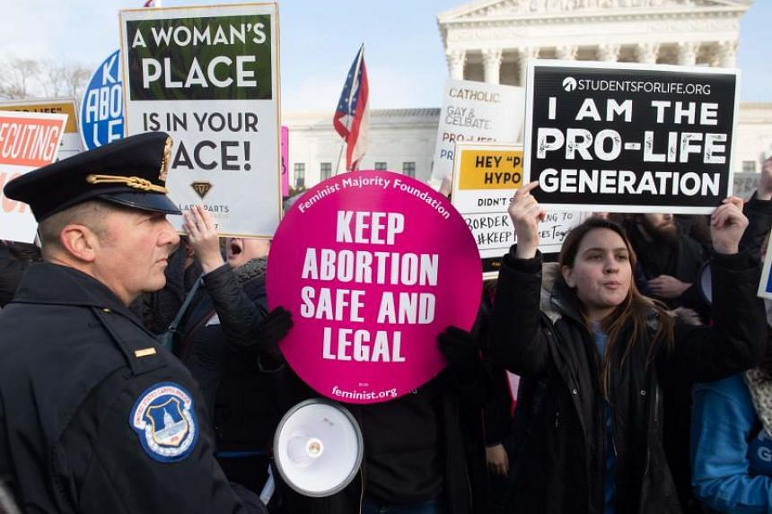 A photo taken on Jan 18, 2019, shows anti-abortion activists outside the US Supreme Court in Washington.