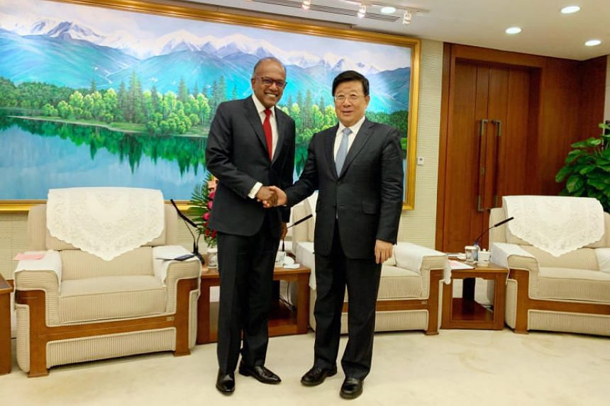 Law and Home Affairs Minister K. Shanmugam with Chinese State Councillor and Public Security Minister Zhao Kezhi in Beijing on Dec 6, 2019.