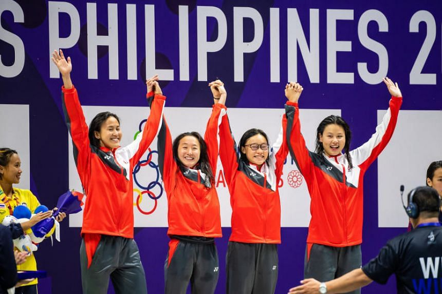 (From left) Singapore's 4x200m freestyle quartet of Quah Ting Wen, Quah Jing Wen, Gan Ching Hwee and Christie Chue smile after winning the gold medal at the 2019 SEA Games in Philippines on Dec 5, 2019.