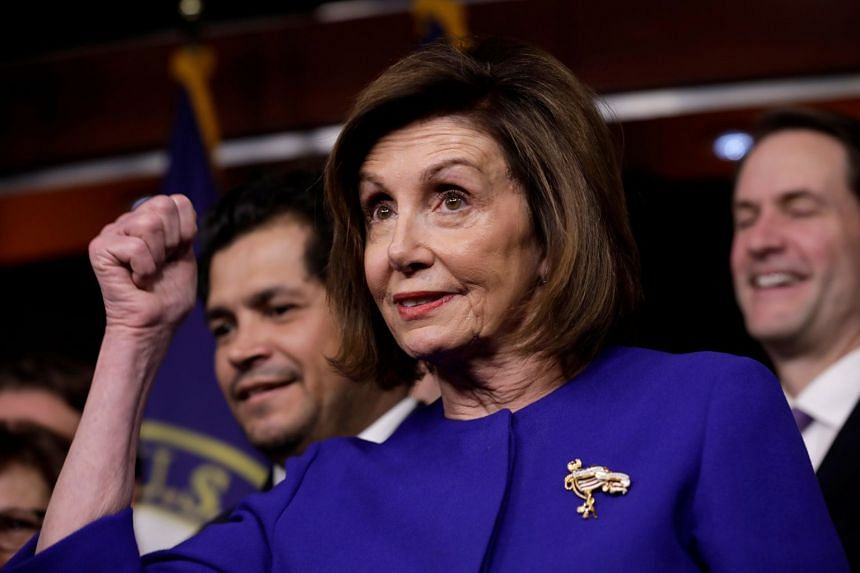 Pelosi gestures during a news conference on the trade agreement on Capitol Hill in Washington.
