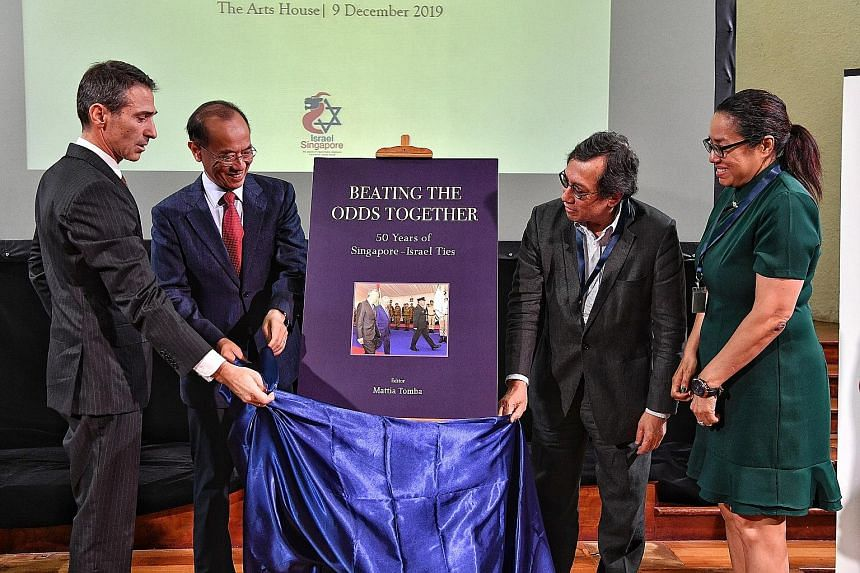 From far left: Israeli Ambassador to Singapore Sagi Karni, former foreign minister George Yeo, retired diplomat Bilahari Kausikan and Middle East Institute acting director Michelle Teo launching Beating The Odds Together: 50 years of Singapore-Israel