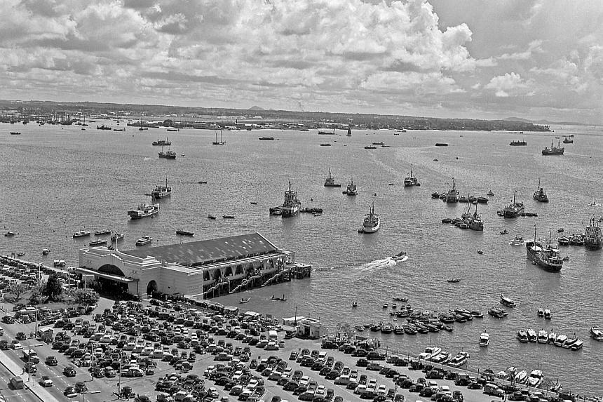 A bird's-eye view of Clifford Pier in 1956. Shophouses at the intersection of Cross Street and Amoy Street in 1955. Mrs Marjorie Doggett in 1957. The self-taught photographer moved to Singapore in 1947 with her husband. One of the highlights of the n