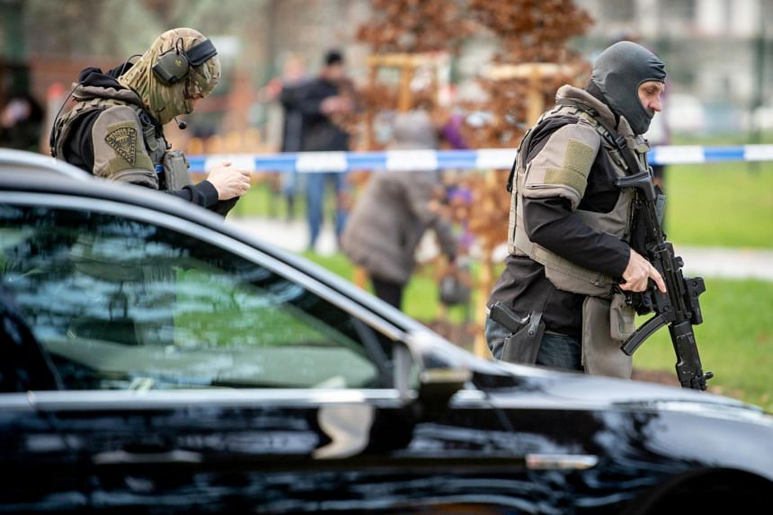 Police officers seen near the site of a shooting in front of a hospital in Ostrava, Czech Republic, on Dec 10, 2019.