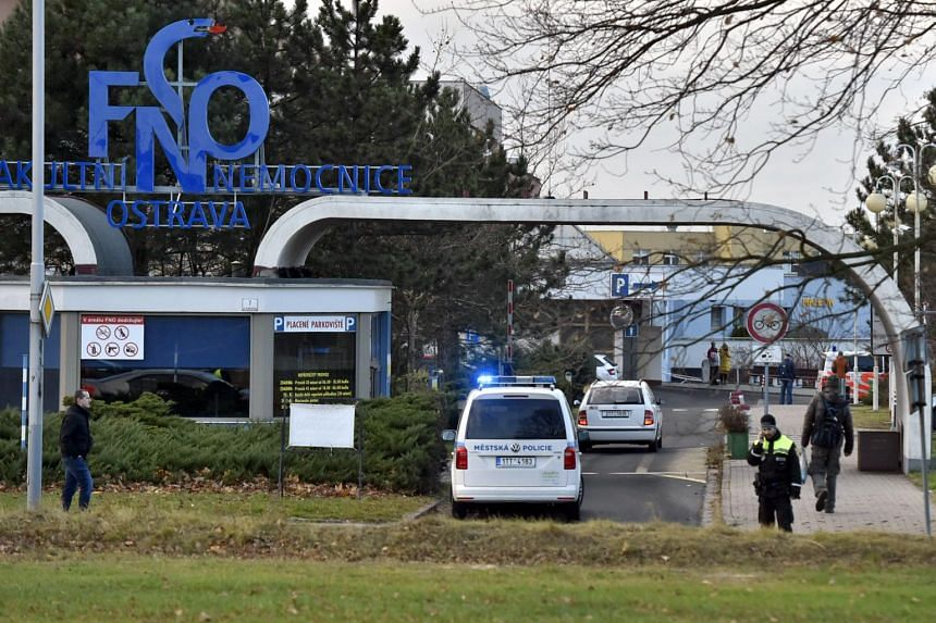 Police cars enter the Ostrava Teaching Hospital after a shooting incident in Ostava, the Czech Republic, on Dec 10, 2019.