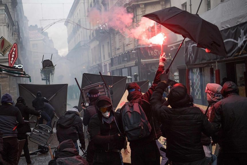 Riot police and protesters clash during a demonstration in Nantes, France, on Dec 7, 2019.