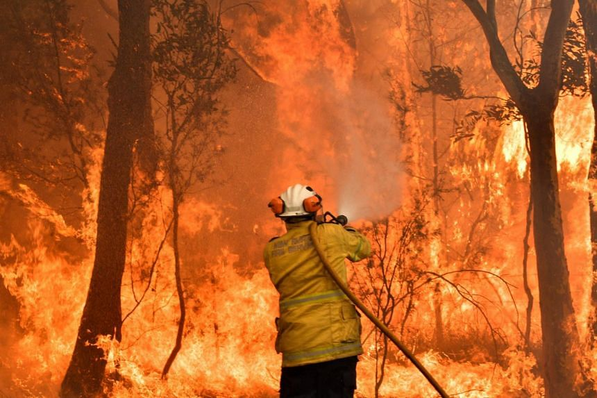 A firefighter secures residential areas from encroaching bushfires in the Central Coast, north of Sydney, on Dec 10, 2019.