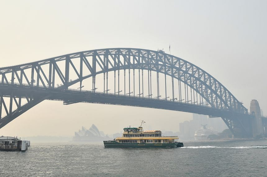 The Sydney Harbour Bridge is seen as smoke haze from bushfires in New South Wales blankets the Central Business District in Sydney, Australia on Dec 10, 2019.
