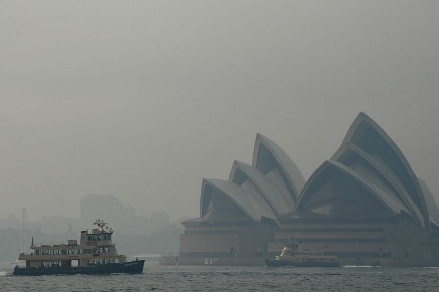The Sydney Opera House is seen as smoke haze from bushfires in New South Wales blankets the Central Business District in Sydney, Australia on Dec 10, 2019.