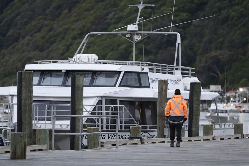 A security guard walks along the wharf in Whakatane, New Zealand on Dec 10, 2019.