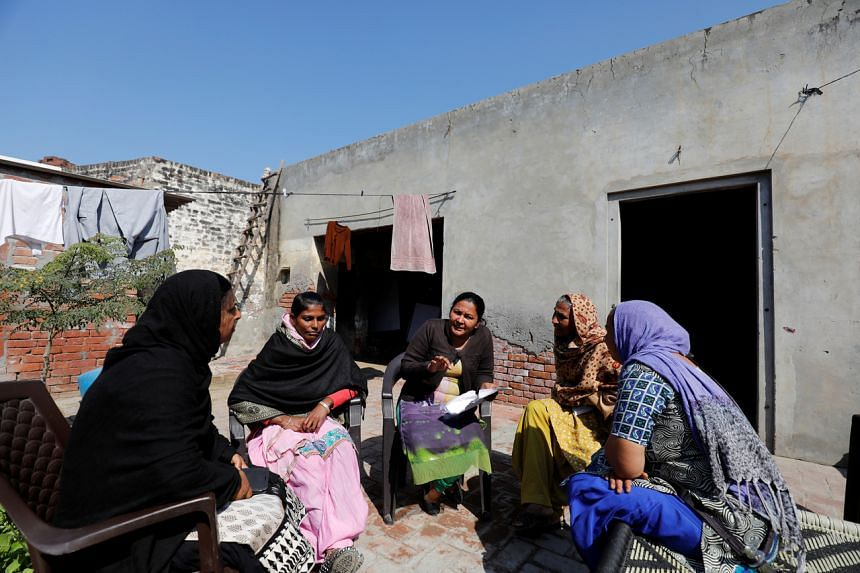 Satwinder Kaur (centre) speaks to a woman who visited Kaur to ask for advice at her house in Punjab, India, on March 9, 2019.