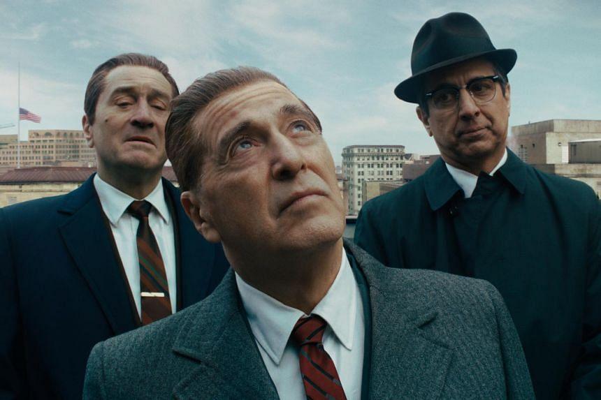 (From left) Robert De Niro, Al Pacino and Ray Romano in a scene from The Irishman.