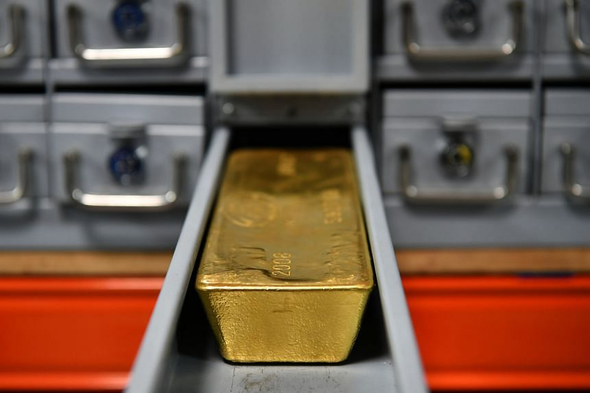 """Goldman analysts said investors should diversify their long-term bond holdings with gold, citing """"fear-driven demand"""" for the precious metal."""