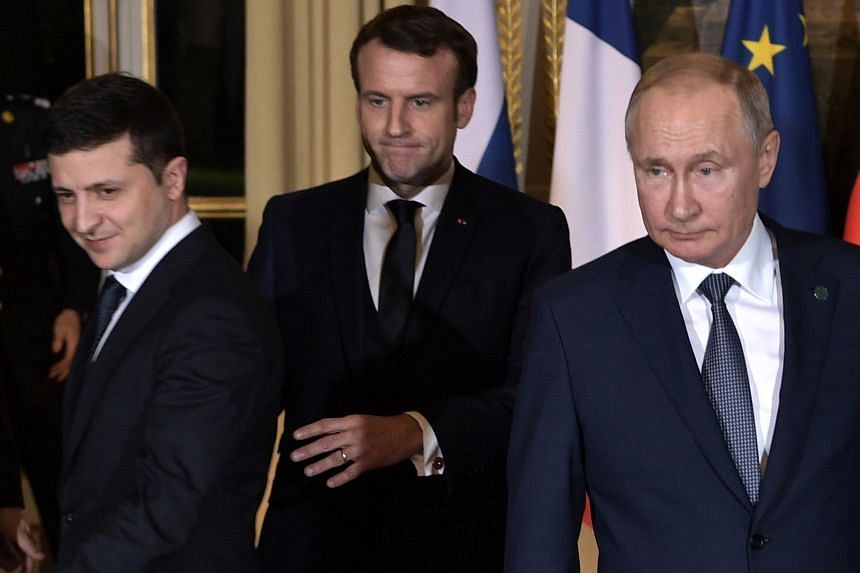 (From left) Ukrainian President Volodymyr Zelensky, French President Emmanuel Macron and Russian President Vladimir Putin arrive for a meeting at the Elysee Palace, on Dec 9, 2019 in Paris.