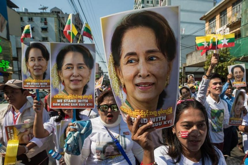 People participate in a rally in support of Myanmar's leader Aung San Suu Kyi in Yangon on Dec 10, 2019.
