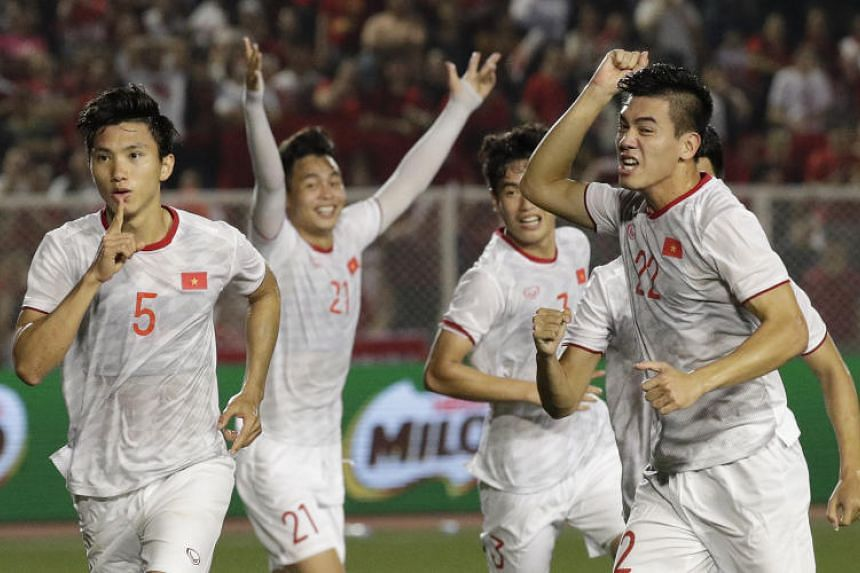 Vietnam players celebrate after a goal by Van Hau Doan (left) during the men's final against Indonesia in Manila on Dec 10, 2019.