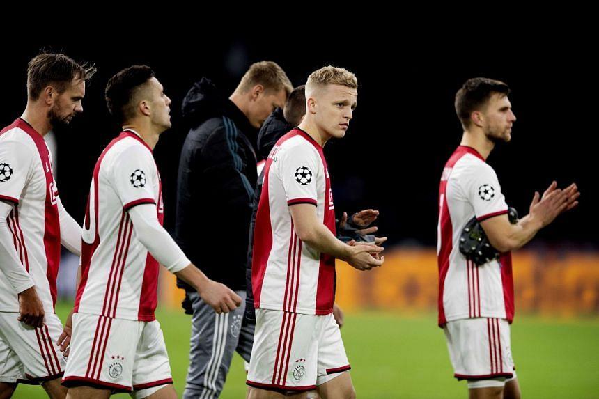 Ajax players react after the match.
