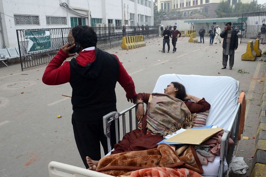 Patients are left unattended outside the Punjab Institute of Cardiology, after lawyers clashed with police and stormed the hospital.