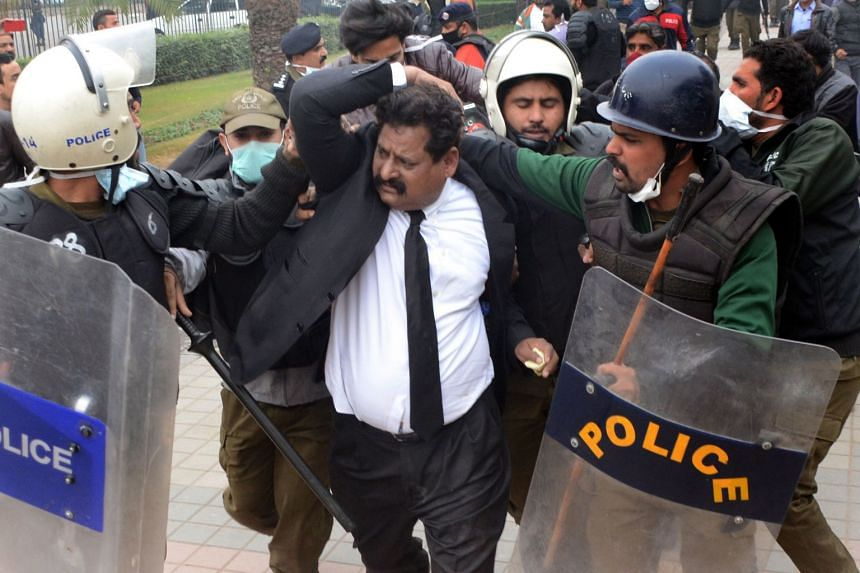 Police arrest lawyers after they clashed with doctors outside the Punjab Institute of Cardiology.